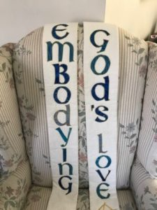 """picture of stole with the message """"embodying God's love"""""""